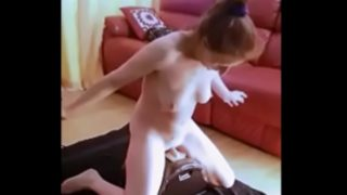 Redhead MILF explodes on Sybian!